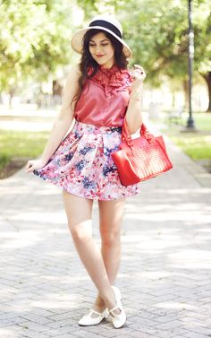 Red ruffle shirt, Floral skirt, White flats, Red purse and White floppy hat.