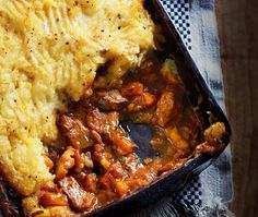 Beef in a tomato sauce with a topping of swede mash
