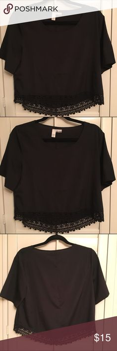 NWOT Black Lace-Trimmed Blouse!!! This is such a simple yet chic black short-sleeved top. NWOT. Brand: Abound. Hangs a little bit lower in the back. Size: XS. Pair it with leather leggings and you are set! 100% poly. Denim shorts also for sale. Tops