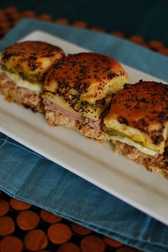 Cuban Sandwich Sliders,marinated overnight in a butter poppyseed mixture, be the star of your Superbowl party by making these!