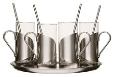 In heat-resistant glass and sleek stainless steel, this Irish coffee set includes four mugs with handles and straw-spoons, and a tray for easy transport.