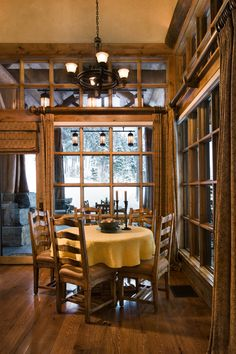 Dining nook. High transoms, wall of windows overlooking covered porch Locati Home -Lakeview Residence