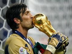 Buffon kisses the World Cup after helping Italy beat France in the 2006 final in Berlin, Germany