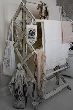 shabby white laundry rack with vintage linens