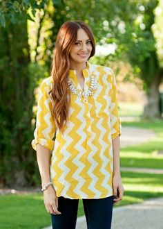 yellow and white chevron blouse with partial button front. #bellaellaboutique