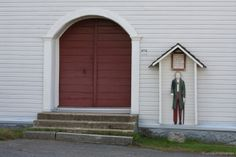 """Finnish """"Vaivaisukko"""" (The poor old man) is a wooden boy standing by the church of Nurmo. These statues can be found in many churches in Finland. The wooden statue has a coin-sized hole in it and people can donate money for the parish. Wooden Statues, I Wallpaper, Finland, Shed, Outdoor Structures, Outdoor Decor, Money, People, Silver"""