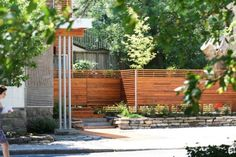 Horizontal slat modern wood fence with Indent at drive way