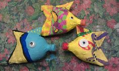 Recycled art project I did with my students.  Cut down 2-liter pop bottles, paper mached and painted. The one on the left is Dory :).  #kidscrafts