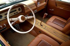 Custom interior of a 1964-66 Chevy Suburban with wood inlay setup. Super cool