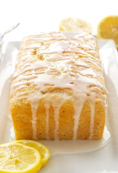 Lemon Yogurt Cake A moist lemon loaf cake made healthier thanks to Greek yogurt! Lemon Desserts, Lemon Recipes, Just Desserts, Cake Recipes, Dessert Recipes, Spring Desserts, Food Cakes, Cupcake Cakes, Lemon Yogurt Cake
