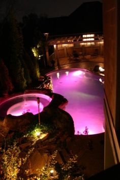 A pink pool! :D. I love to swim, but it would be cool to swim here!