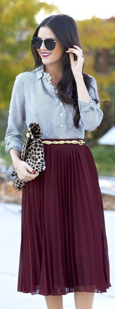 Styling skirts for fall/winter! Yes, you can still wear your favorite skirts! Try pairing up a rich color with a dainty pattern - like this marsala shade with a charcoal/white pin stripe top! Add some statement accessories like a great belt, necklace or clutch for the finishing touch!