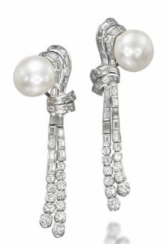 A PAIR OF CULTURED PEARL AND DIAMOND EARRINGS, BY BULGARI.  Each with a button-shaped cultured pearl top to the twin scrolling baguette-cut diamond lines with graduated brilliant-cut diamond terminals, mounted in platinum and gold, 7.1 cm  Signed Bulgari
