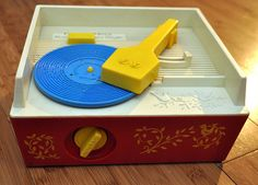 Fisher Price Record Player. 1970's.   I still have my sister's.. I don't think I'll ever get rid of it, just to remind myself what we all had before ipads and such!!