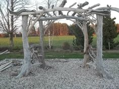 This is a permanent installation of a beautiful 4-leg pergola. The legs are tree trunks! All the wood is driftwood! Some construction skills required!