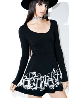 Sourpuss Clothing Grave Digger Skater Dress for everyone that's six feet under. This xtra comfy long sleeve dress features a contrasting tombstone illustration all around yer bod with a fun skater skirt, scoop neckline and stretchy material that hugs all yer deadly curves.