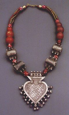 Cornaline d'Aleppo and India Silver Necklace. Materials: India silver, cornaline d'aleppo (red yellow center, oldest), red eye beads, copper ndali beads (made from wire of downed telegraph poles). | Wild Geese Vintage Designs