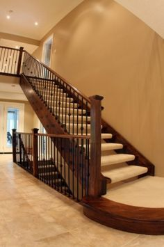 Now I can visualize how the stair design will look, open risers against a 2-storey wall and open basement stairs.