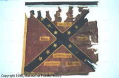 Battle Flag of the 8TH REGIMENT Florida Volunteer Infantry. St. Andrew's cross design; square format. Captured at Sailor's Creek on April 6, 1865 by Sergeant A.A. Clapp, 2nd Ohio Cavalry, attached to the 3rd Cavalry Division, General George Custer commanding.. Includes original wooden flag staff marked with capture number.