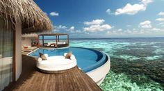 Exotic Circular Pool with White Round Mattress and Wooden Deck