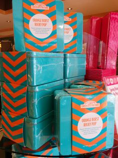 Rocky Mountain Chocolate Factory Spring Sea Salt Chocolate Rocky Pop™ Tin. Custom square RMCF orange and blue chevron tin. #rockymountainchocolatefactory