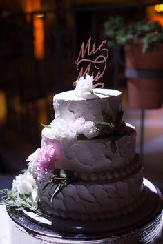 White wedding cake; cake topper; three tier wedding cake