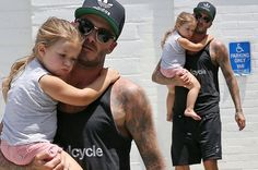 Doting daddy Beckham! David Beckham holds daughter Harper while walking his dog Coco to the groomers - 3am & Mirror Online