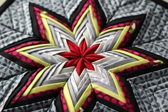 Fancy Folded Star - I LOVE the patterned fabric in the background. Beauteous!