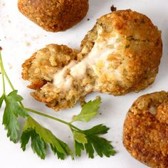 Vegetarian Cheese and Onion Stuffed Quinoa Arancini with step-by-step pictures.