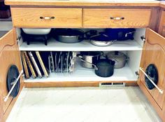 Pots and Pans reorganization...I like the idea of the small curtain rod on the door for most used pot lids!