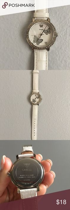White leather Guess watch Adorable little watch from Guess. Has only been worn a couple times. Everything is in perfect condition. It just needs a new battery. The backing has never been opened. All the crystals are intact and the leather is almost perfectly pristine. Guess Accessories Watches
