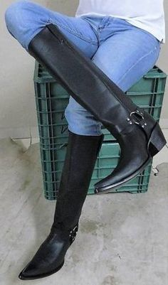 Jeans in tall custom harness boots.