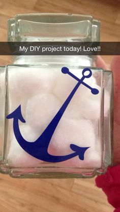 Jar from the dollar tree. Added an anchor.  Put cotton balls inside. Perfect as a little added decor for the bathroom!