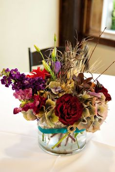 An unexpected color palette in this fall centerpiece by Blossom Sweet.