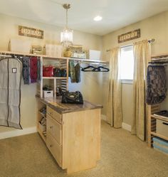Large closet for the master suite with lots of shelving and built-in cabinet storage