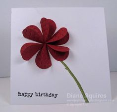 Flower looks to be made with hearts - could adapt for a valentine - - - birthday card: 3-D flower using heart punch