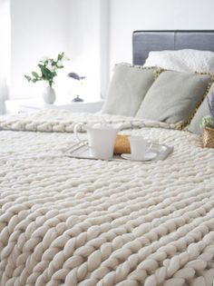 I am pretty much dying to find something that is chunky knit! I love it. How awesome would this be once it starts getting really cold?! Blankets, sweaters, scarves, socks…anything! Now I need to figure out how to make one of these cozy blankets to wrap myself up in during winter…So if anyone knows …
