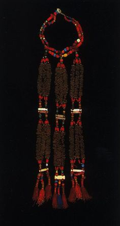 Palestine | Necklace worn by the Negev bedouin women; A variety of beads, cloves, and mother of pearl spacers. Clove necklaces were associated with weddings. | ©Weir, shelagh. Palestinian costume.1989