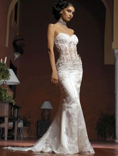 Above is a sexy sheer lace corset wedding dress with satin. It is ...