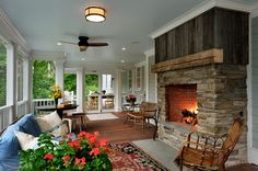 Peaceful screened in porch with stone fireplace - so warm and comforting.