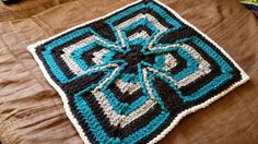 http://www.ravelry.com/patterns/library/celtic-cross---may-wwbamcal