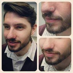 Low double nostril piercing.