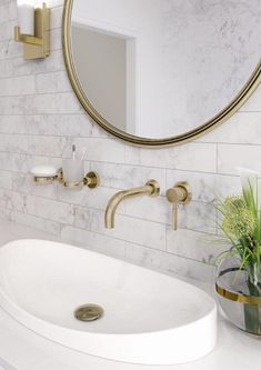 Gorgeous carrara marble bathroom with gold taps and accessories for a classy colour pop!