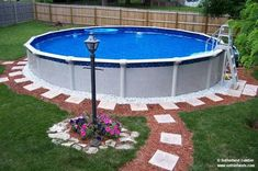 The Ultimate Guide to Above-Ground Pool Ideas with Picture Do you need some inspiration for pool deck designs? 20 awesome above ground pools with decks, showcasing the myriad shapes and styles available on a budget. Above Ground Pool Landscaping, Above Ground Pool Decks, Above Ground Swimming Pools, In Ground Pools, Landscaping Plants, Landscaping Ideas, Installing Above Ground Pool, Sidewalk Landscaping, Patio Fire Pits
