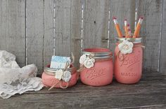 Rustic mason jar desk set. Hand painted in coral, lightly distressed, tied with jute and ivory colored roses, finished with a protective coating. Accessorize yo