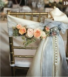 Bride's chair decorated with garden roses and cascading pearls… romantic, vintage, wedding flowers