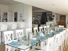 Angmering-On-Sea Beach House Dining Room. White and blue dining room interior