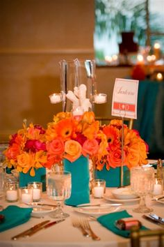 orange and teal reception wedding flowers, wedding decor, wedding flower centerpiece, wedding flower arrangement, add pic source on comment and we will update it. www.myfloweraffair.com can create this beautiful wedding flower look.