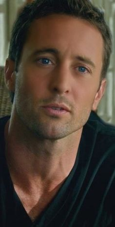Alex O'Loughlin  I am not into beards, goatees, or mustaches. But I love the scrubby unshaved look on Alex. Now this is tall, dark (blue is his color) and self confident sporty guy.