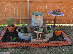 Used upcycled washbins & old coal bucket that my mom had to make my Herb Garden.  Easy and fun project!